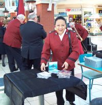Elsie Morris sets up the CD sales table