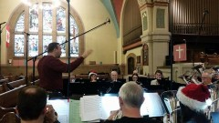 Bandmaster John Lam conducts the Canadian Staff Band in a recording session, April 2015