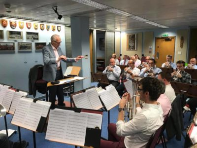 Major George Whittingham (R) conducts the International Staff Band