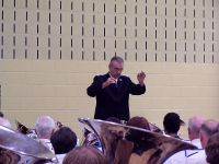 Bandmaster Charles Baker conducts the massed band