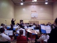 Another view of Bandmaster Baker and the massed band