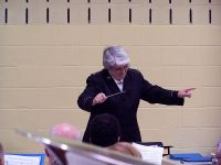 Bandmaster Peggy Thomas conducting the massed band