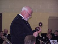 Bandmaster David Hulteen, with maracas