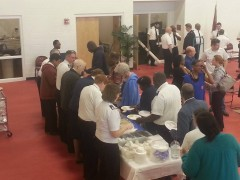 Members of the National Capital Band serve a community meal at Suffolk Corps