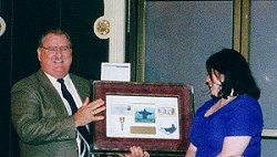 Major Todd Smith presenting recognition plaque to Dorothy Gates