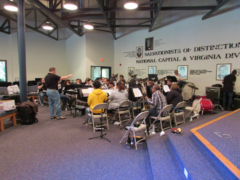 Dr. Brian Appleby-Wineberg leads the Divisional Youth Band in rehearsal.