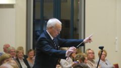 "Brian Towse conducts ""Celebration"" (Leslie Condon)."